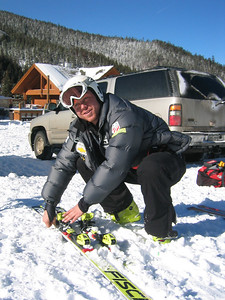 JJ Johnson checks his skis before heading up the hill for training at Keystone Resort.