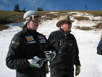 Coach Jonna Mendes and NDS Director Walt Evans watch young athletes make GS turns at the top of Copper Mountain's Ptarmigan run.