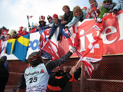 Jimmy Cochran reaches to sign a flag for a fan at Adelboden  (credit: Doug Haney/U.S. Ski Team)
