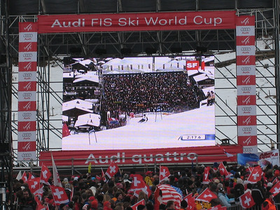 Jimmy Cochran screams into the finish arena during the second run of giant slalom in Adelboden as a U.S. flag flies in a sea of Swiss (credit: Doug Haney/U.S. Ski Team)