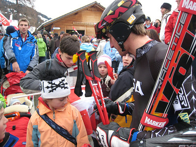 Jimmy Cochran signs autographs for young fans after finishing 17th in the Adelboden giant slalom (credit: Doug Haney/U.S. Ski Team)