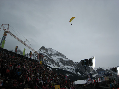 A paraglider flies in tnto the finish prior to the start of the giant slalom in Adelboden (credit: Doug Haney/U.S. Ski Team)