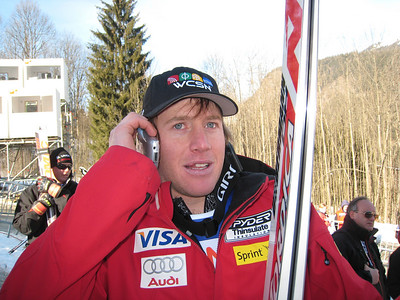 Marco Sullivan talks on the phone with injured teammate Scott Macartney after winning the first World Cup of his career  (Doug Haney/U.S. Ski Team)