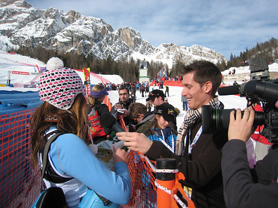 Julia Mancuso receives a gift from Italian television after finishing second in the first of two super Gs in Cortina (Doug Haney/U.S. Ski Team)