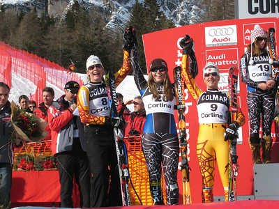 Lindsey Vonn (center) celebrates with Canadians Emily Brydon (left) and Britt Janyk (right) after the trio finished 4-5-6 in the first of two super Gs in Cortina (Doug Haney/U.S. Ski Team)