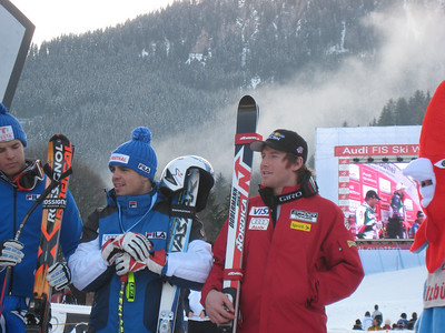 Tenth place finisher Marco Sullivan (Squaw Valley, CA) and Italy's Peter Fill (ninth place) at the awards ceremony for the Kitzbuehel SG on Jan. 18, 2008. Credit: U.S. Ski Team/Juliann Fritz)