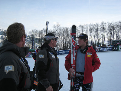 Squaw Valley's Marco Sullivan discusses his super G run with Men's Head Coach Phil McNichol and Strength and Conditioning Manager Per Lundstum while awaiting the awards ceremony. (Credit: U.S. Ski Team/Juliann Fritz)