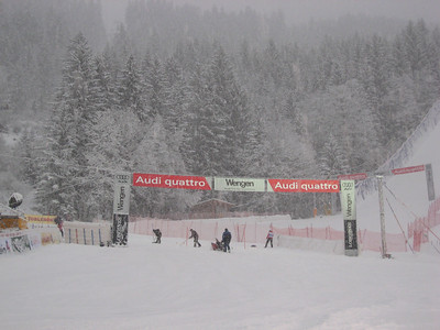 A course worker snow blows the finish line prior to the start of the Wengen slalom (Doug Haney/U.S. Ski Team)