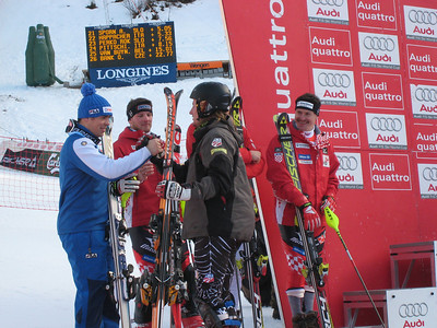 Ted Ligety, 5th, congratulates Italian Peter Fill, 10th, during the super combined awards ceremony in Wengen (Doug Haney/U.S. Ski Team)