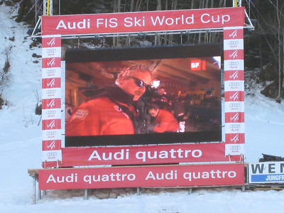 The big screen in the finish area shows Pete Lavin (aka Baby Huey) while firing up Andrew Weibrecht prior to his third downhill training run in Wengen (Doug Haney/U.S. Ski Team)