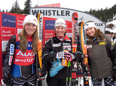 The women's downhill podium smiles including Lindsey Vonn (left), Nadia Styger (center) and Julia Mancuso. U.S. Ski Team racer Lindsey Vonn finished second by a mere .01 to take the Audi FIS World Cup downhill title on the Olympic venue in Whistler, BC. Photo: Doug Haney/U.S. Ski Team