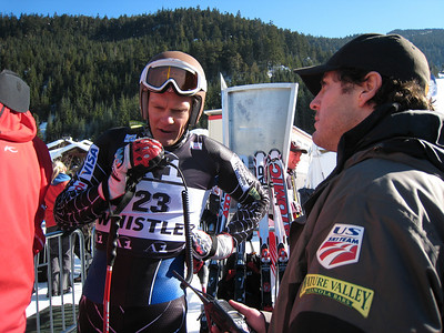 Steven Nyman radios up a course report to his teammates with the help of Scott Macartney. Photo: Doug Haney/U.S. Ski Team