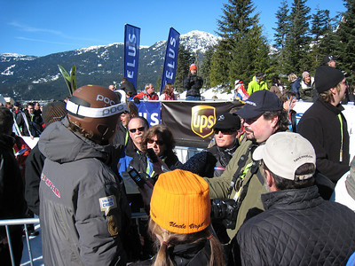 Steven Nyman interviews with media in the Whistler finish area after the men's super G. Photo: Doug Haney/U.S. Ski Team