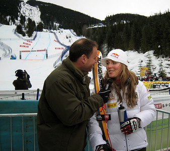 U.S. Ski Team racer Lindsey Vonn does a live TV interview after finishing second by a mere .01 to take the Audi FIS World Cup downhill title on the Olympic venue in Whistler, BC. Photo: Doug Haney/U.S. Ski Team
