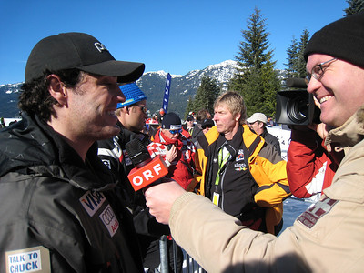 Scott Macartney interviews with ORF in the finish area during the men's super G in Whistler. Photo: Doug Haney/U.S. Ski Team