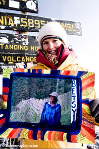Julia Mancuso holds a photo of her grandmother after summiting Mt. Kilimanjaro to raise money for Right to Play (http://www.laurenrossphoto.com)