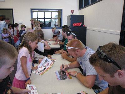 Men's alpine team signing autographs at the Sugarhouse Boys & Girls Club in Salt Lake City (July 23, 2007). Children include: Coming in the door (pink tank top) Embrace Archuleta, Mattleynn Plavchak, Colton Cazier, Dillen Wright.  At the table Chloe Lee and Jacob Morgan. Photo credit: Juliann Fritz/USSA