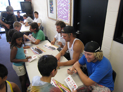 Men's alpine team signing autographs at the Sugarhouse Boys & Girls Club in Salt Lake City (July 23, 2007). Children include: (back to front) Jacob Morgan, Sydney Roque and Carlos Haycock. Photo credit: Juliann Fritz/USSA