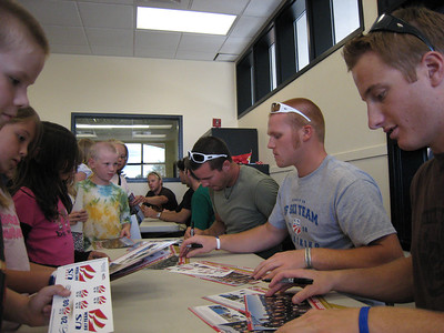 Men's alpine team signing autographs at the Sugarhouse Boys & Girls Club in Salt Lake City (July 23, 2007). Children include: (back of to front) Kamarin Barclay, Tyler Petro, Jayda Feraco, Chloe Lee and Jacob Morgan. Photo credit: Juliann Fritz/USSA