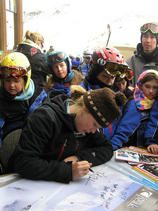 U.S. Ski Team's Kaylin Richardson surrounded by a mob of young fans at Coronet Peak's 60th birthday party in New Zealand (credit: Coronet Peak Ski Area)