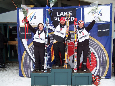 North American Cup Giant Slalom winner Shona Rubens of Canada (middle) celebrates Thursday's victory outside the Whiteface  Mountain base lodge. Second place went to Leanne Smith (left), while Caitlin Ciccone placed third.  Photo © ORDA Photo