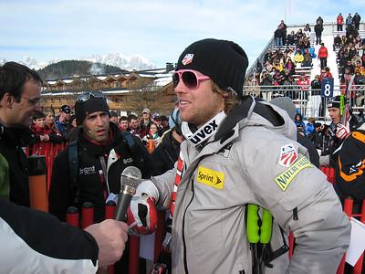 Erik Fisher interviews after finishing 11th in the famed Hahnenkamm downhill in Kitzbuehel (Doug Haney/U.S. Ski Team)