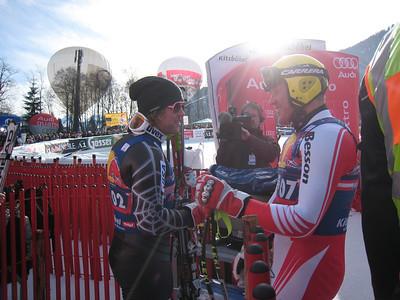 Erik Fisher congratulates Austrian great Hermann Maier during the Hahnenkamm downhill in Kitzbuehel (Doug Haney/U.S. Ski Team)