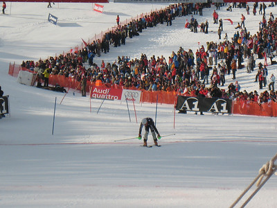 Ted Ligety reaches across the finish line during the first slalom run in Kitzbuehel (Doug Haney/U.S. Ski Team)