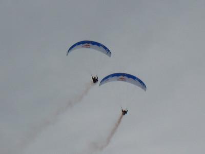 Red Bull paragliders soar into the finish stadium prior to the super G start in Kitzbuehel (Doug Haney/U.S. Ski Team)