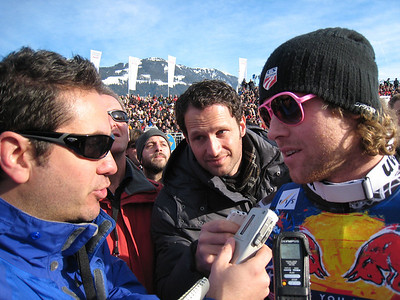 Erik Fisher interviews with journalists after finishing 11th in the famed Hahnenkamm downhill at Kitzbuehel (Doug Haney/U.S. Ski Team)