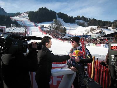 Erik Fisher interviews live on Swiss television after finishing 11th in the storied Hahnenkamm downhill in Kizbuehel (Doug Haney/U.S. Ski Team)