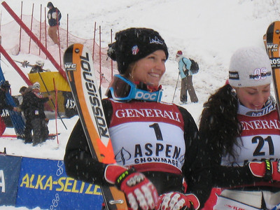 Julia Mancuso smiles during the flower ceremony after finishing eighth in giant slalom at the Aspen Winternational. Photo: Doug Haney/U.S. Ski Team