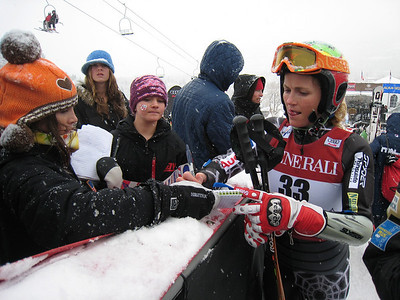 Sarah Schleper signs autograpsh for fans in the finish area at the Aspen Winternational. Photo: Doug Haney/U.S. Ski Team