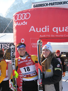 Lindsey Vonn smiles in the finish with best friend Maria Riesch after winning the super G in Garmisch to tie Tamara McKinney for the most World Cup wins by an American woman (Doug Haney/U.S. Ski Team)