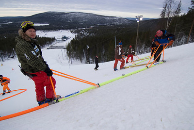 Course workers in Levi, Finland work the injection bars to harden the competition slope in preparation for the opening World Cup slalom.  Photo © Laplandfoto.com/Paul Palmer For editorial use only, contact paul.palmer@laplandfoto.com for other use.