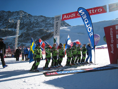 A local ski club holds the nations flags at the podium ceremony in Soelden.   2009 Audi FIS Alpine World Cup Solden, Austria Photo: Doug Haney/U.S. Ski Team