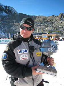 World Cup technical coach Pete Korfiatis poses with Ted Ligety's trophy for finishing third in the opening World Cup giant slalom in Soelden.   2009 Audi FIS Alpine World Cup Solden, Austria Photo: Doug Haney/U.S. Ski Team