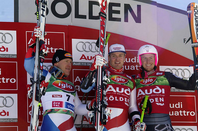 Swiss skiers Didier Cuche, Daniel Albrecht and reigning World Cup giant slalom champion Ted Ligety of the U.S. Ski Team on the podium in Soelden.  2009 Audi FIS Alpine World Cup Solden, Austria Photo © Paganella