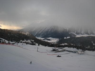 Fog hangs over the finish area in St. Mortiz, Switzerland prior to the start of the first downhill training run. Photo: Doug Haney/U.S. Ski Team
