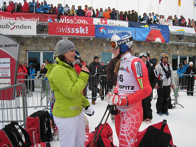 Lindsey Vonn interviews in the finish and shows off the new color Spyder speed suit special for the St. Moritz speed races. Photo: Doug Haney/U.S. Ski Team