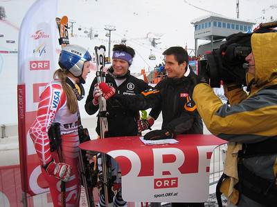 Lindsey Vonn and Maria Riesch of Germany interview in the finish. Vonn shows off the new color Spyder speed suit special for the St. Moritz speed races. Photo: Doug Haney/U.S. Ski Team