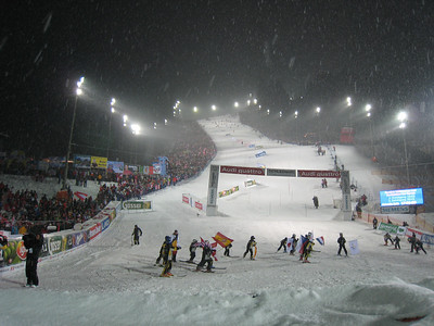 Flag bearers from local ski clubs skate out of the finish prior to the start of The Night Slalom in Schladming  (Doug Haney/U.S. Ski Team)
