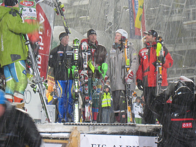 Bode Miller and Ted Ligety chat on the podium after finishing 8-9 respectively in the snowy Schladming night slalom (Doug Haney/U.S. Ski Team)