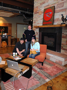 Rossignol's Francois Goulet and Thor Verdonk pose with the U.S. Ski Team's Lindsey Vonn as she prepares for a satellite media tour with sponsor Red Bull at the U.S. headquarters of Rossignol in Park City, Utah.