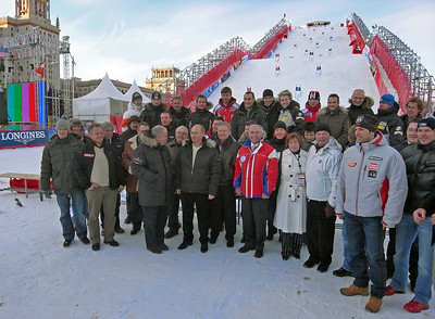 Athletes and Team officials stand in front of a towering scaffold constructured for a dual slalom featuring the top Audi FIS World Cup skiers in downtown Moscow, Russia