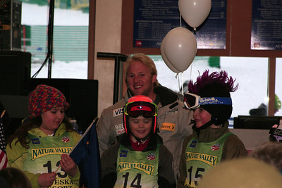 Andrew Weibrecht poses with young racers during the opening ceremonies at Alyeska (Jen Desmond/USSA)