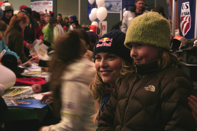 Lindsey Vonn poses for pictures with children at the Opening Ceremony autograph signing at the Nature Valley U.S. Alpine Championships (Jen Desmond/USSA)