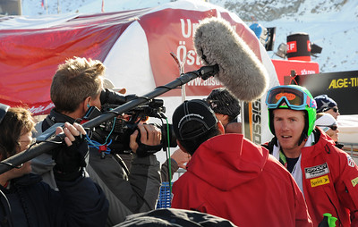 Ted Ligety talks to film crews in the finish at the Audi FIS World Cup in Soelden. (U.S. Ski Team)