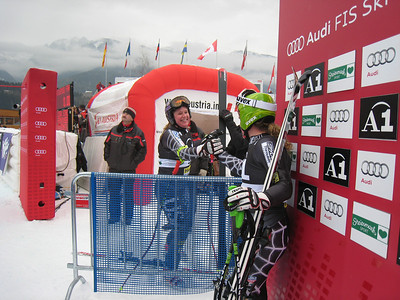 Alice McKennis congratulates Stacey Cook in the leader box at Haus im Ennstal. Both would finish in the top 20 in the first of two downhills (Doug Haney/U.S. Ski Team)