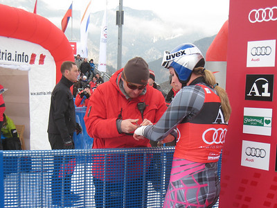 Lindsey Vonn has tape cut off her injured left wrist by her Red Bull trainer Martin Hager following a downhill victory in Haus im Ennstal. It was the 26th victory of her career (Doug Haney/U.S. Ski Team)